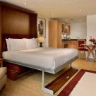 City Docklands Serviced Studio Apartment - Bed opened