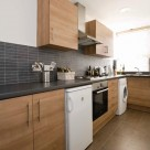 Dolphin House Serviced Apartment - Kitchen