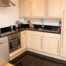 140 Minories Serviced Apartment - Kitchen with all equipments ready for guest stay