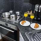 Sanctum Serviced Deluxe 1 Bedroom Apartments - Kitchen