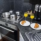 Sanctum Serviced Deluxe 1 Bedroom Apartments - Kitchen
