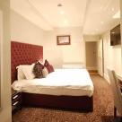 Leonard Apartments Deluxe Three bedroom - Soothing Bedroom