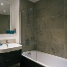 Banyan Wharf Apartment - Marble bathroom