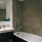 Banyan Wharf Apartment - Marble bathroom