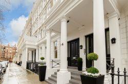 LAK Apartments - White stucco exterior